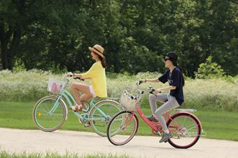 Two people on bicycles.