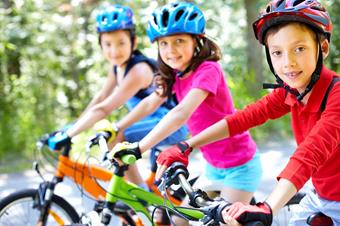 Three children on their bicycles.