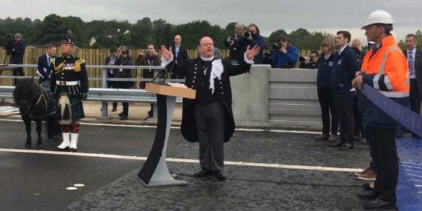 Moderator blessing the new bridge